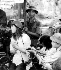 Jane Fonda looking admiringly at an NVA gun crew