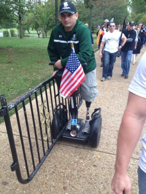 soldier segway returning Obama barricade